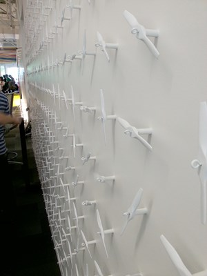 A wall decorated with little propellers, same as found on Noogler's hats given to every new Google employee - Noogler.